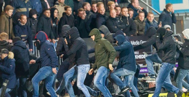 Twente-fans betreden het veld en zoeken confrontatie met Den Bosch-aanhang