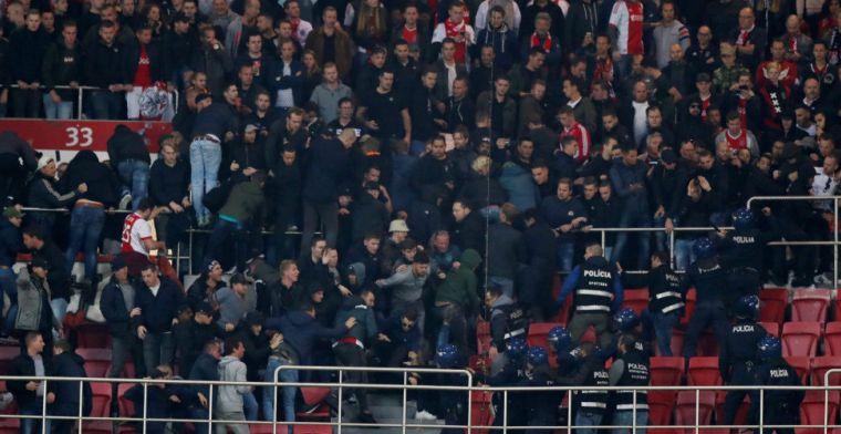 'Straf voor Ajax dreigt na rellen tussen fans en politie: UEFA stelt onderzoek in'
