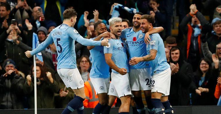 City wint beladen derby en zet United op twaalf punten; Arsenal redt punt