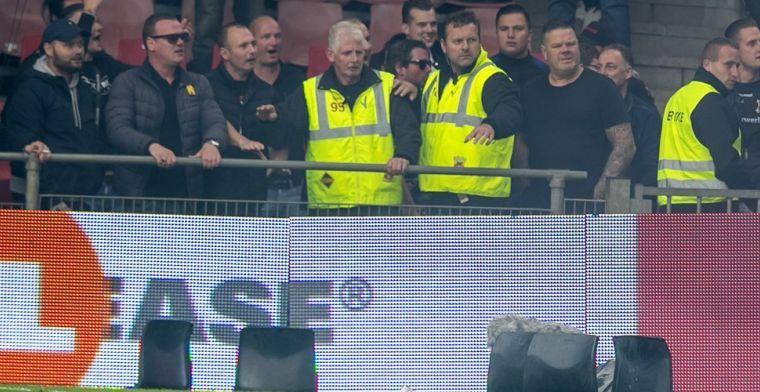 Het loopt mis in Nederland: fans bestoken elkaar met vuurwerk, stoeltjes op veld